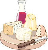 Decanter of red wine by plate of cheese