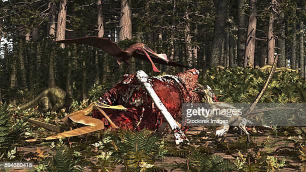 Deinonychus & Coloborhynchus birds feed on a dinosaur carcass.