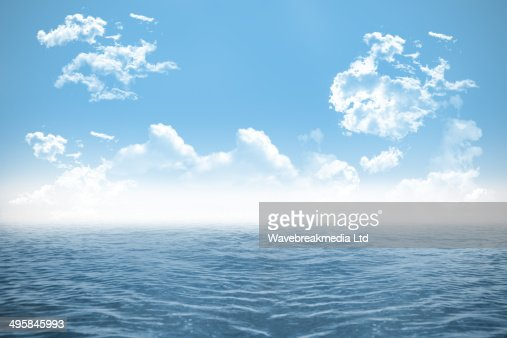 Open sea under cloudy blue sky : Stock Illustration