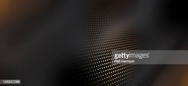 Diminishing dot pattern against an abstract background