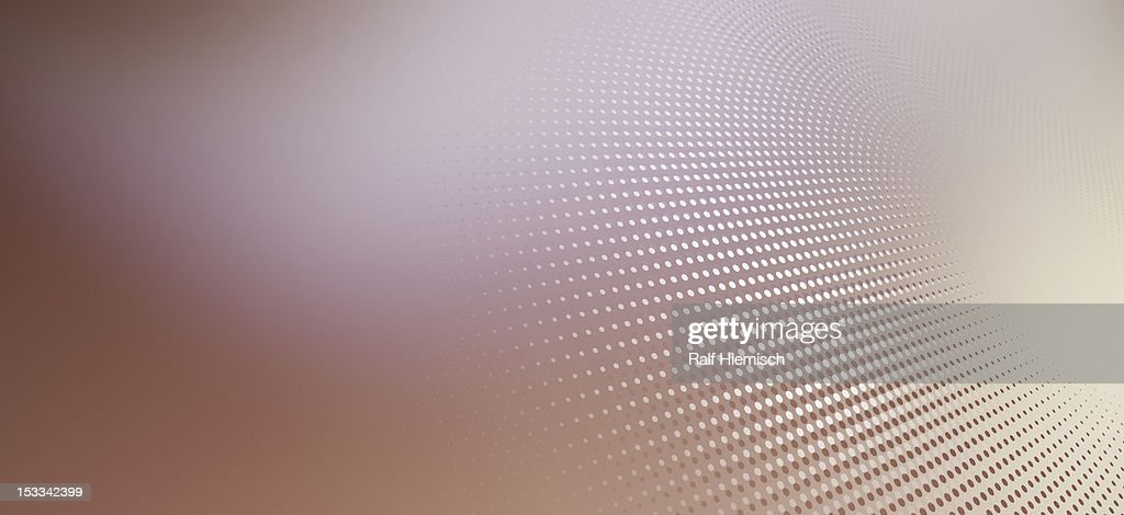 Diminishing dot pattern against an abstract background : Stock Illustration