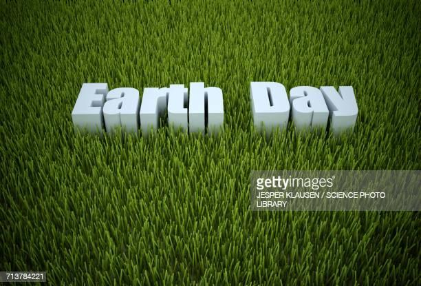 Earth day written in green grass