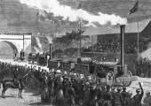 English railway engineer George Stephenson's locomotive 'Rocket' comes in first at the trials competition held at Rainhill Bridge 1829