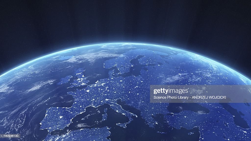 Europe at night. Computer artwork of the Earth from space with lights glowing in urban areas.