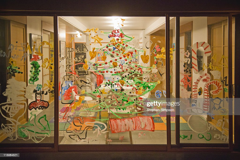 family home windows painted with Christmas symbols : Stockillustraties