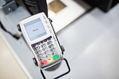 Focus on machine for credit card in a grocery store