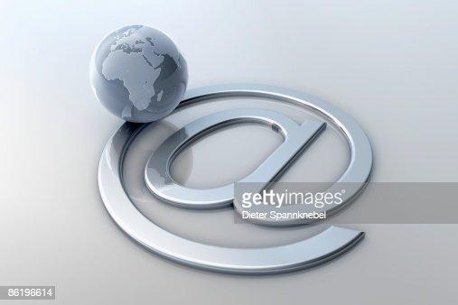 Globe orbit on an Internet 'at' symbol : Stockillustraties