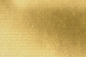 Gold metallic background, brown paper, linen texture, bright festive and business backdrop