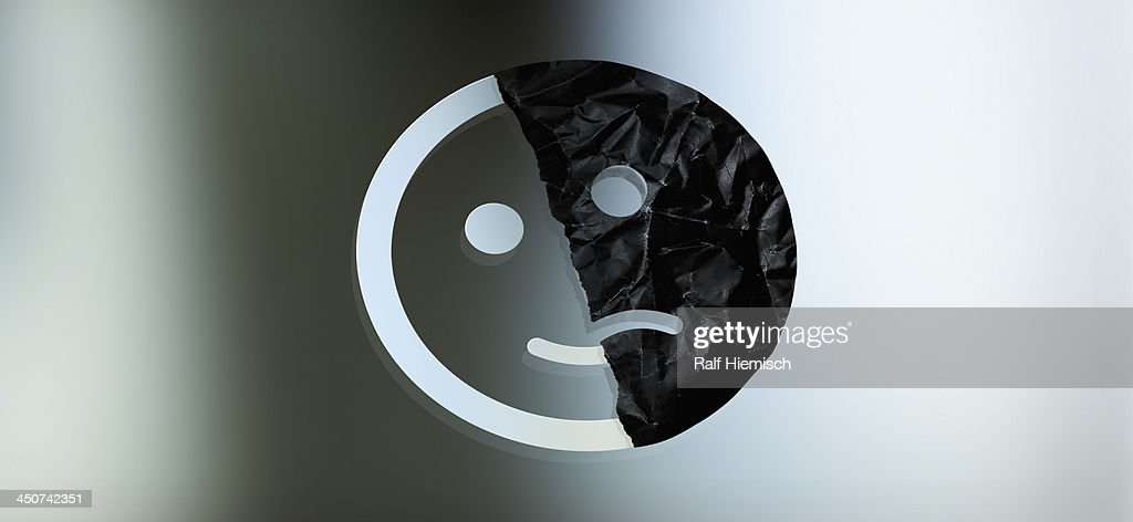 Graphic of a face half smiling and half sad against a gradient background : Stock Illustration