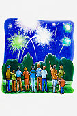 Group of people watching fireworks display in a park