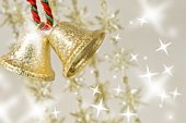 Hanging gold Christmas bells with star shaped illuminations