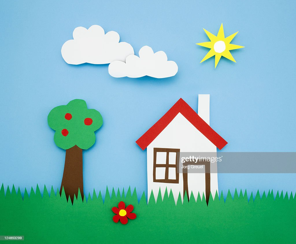 A house and a tree on a meadow : Ilustração de stock
