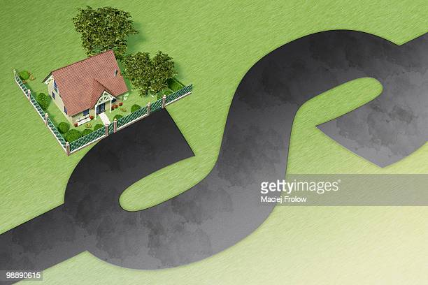 House on border of road in shape of dollar symbol