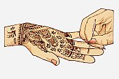 Illustration of henna tattoo being drawn on a hand