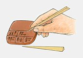 Illustration of using reed pen to write Sumerian cuneiform script on clay tablet