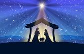 Jesus Nativity in the stable. Figures are in black silhouette against blue starry sky, in the desert setting. Figures are made in Inkscape and applied to illustration in Photoshop.