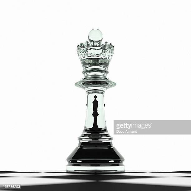 King challenged by queen on chess board