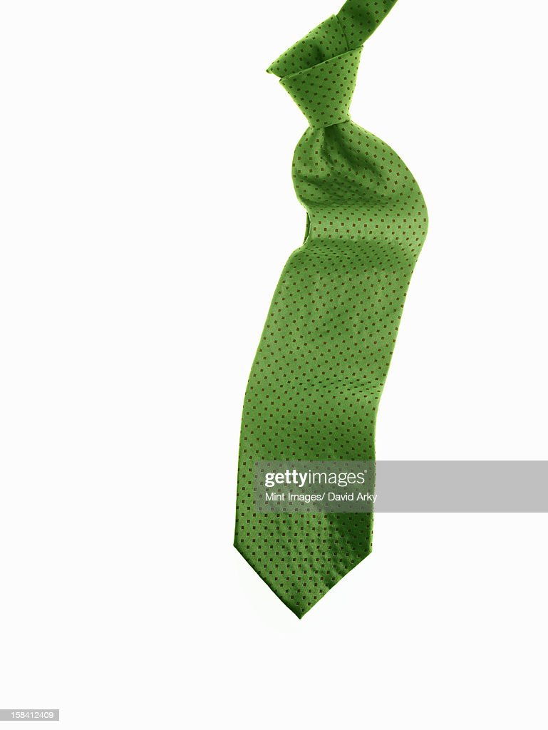 A knotted green fabric tie, or necktie. : Stock Illustration