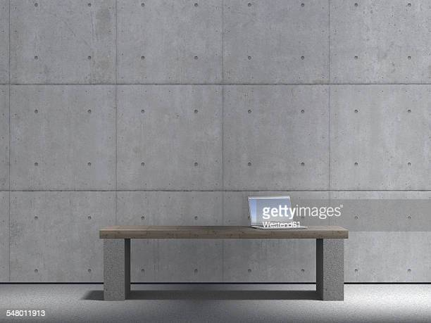 Laptop standing on bench in front of concrete wall, 3D Rendering
