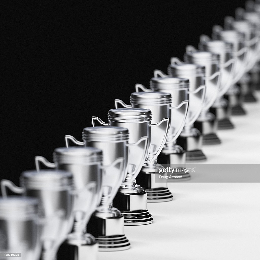 A long line of trophy cups : Stock Illustration