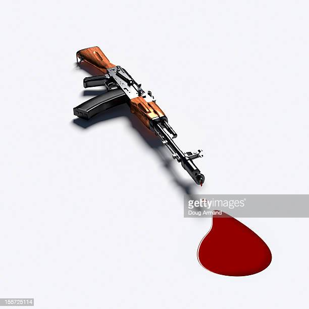 AK-47 Machine dripping blood on white surface