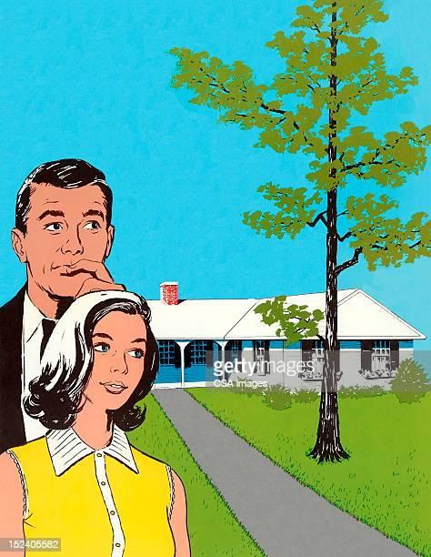 Man and Woman Looking at House