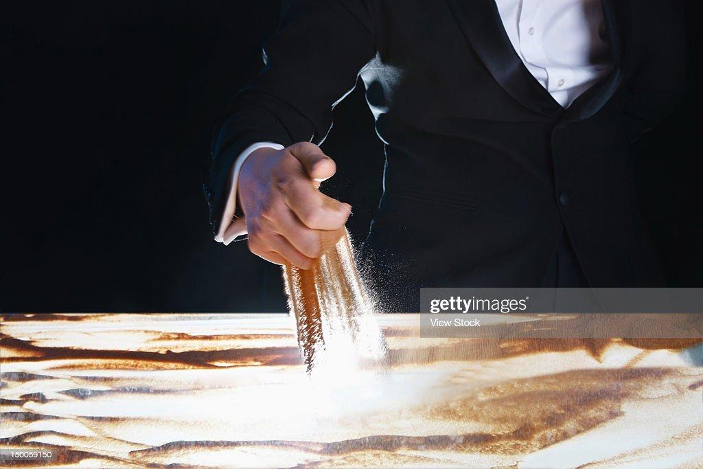 Man creating sand painting : Stock Illustration