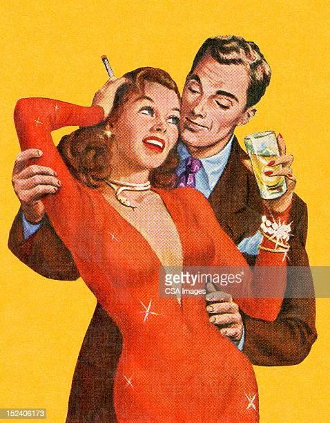 Uomo abbracciare donna in abito rosso