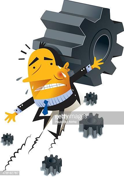 A man underneath gears
