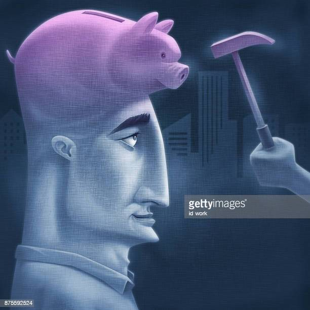 man with piggy bank and hammer