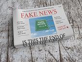 US Media Concept: Pile of Newspapers Fake News On Scratched Old Wood, 3d illustration