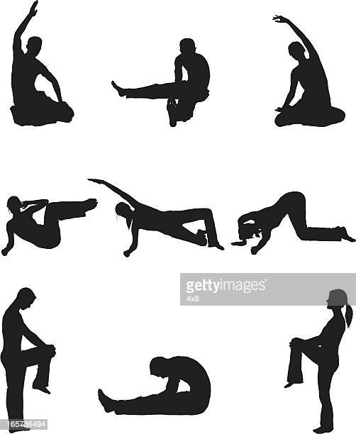Men and women doing yoga stretchs