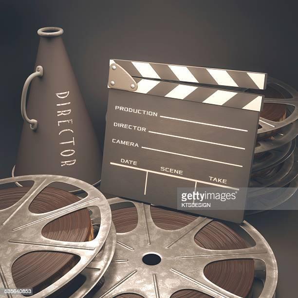 Movie reel, clapperboard and megaphone