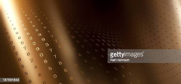 Multiple rows of random numbers on a curving gold surface
