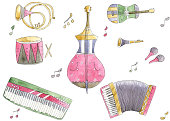 Set of musical instruments drawn with watercolor.