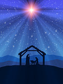 Nativity scene in the desert. Figures are in dark blue silhouette against blue starry sky, with comet star lightbeam. Figures are made in Inkscape and applied to illustration in Photoshop.