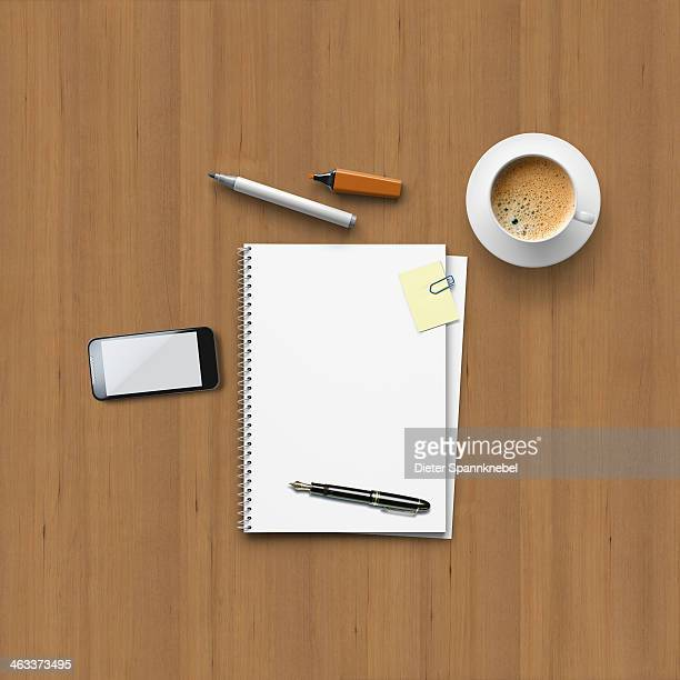Office utensils for a meeting on a wooden table