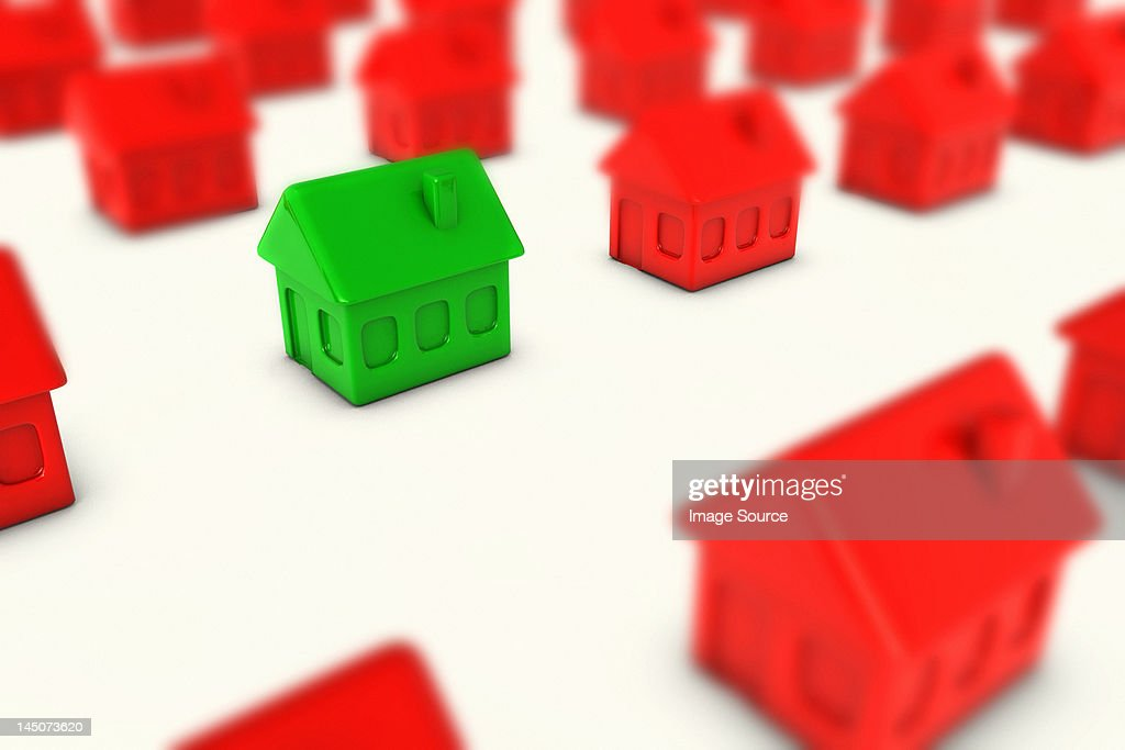 One green house amongst many red houses : Stock Illustration