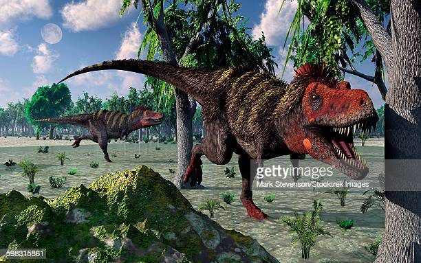 A pair of carnivorous Tarbosaurus dinosaurs hunting for food in what is modern day Asia.