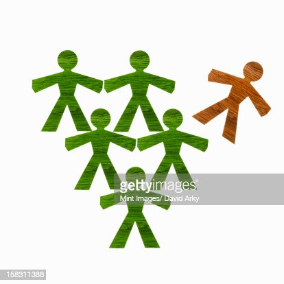 Papercuts, paper cut out figures representing people. Five green and one brown figure. : Stock Illustration