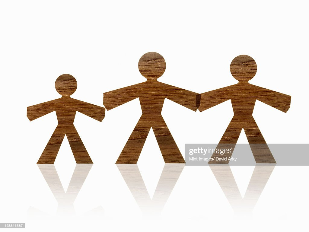 Papercuts, paper cut out figures representing people. Two large and one smaller one, family. : Stock Illustration