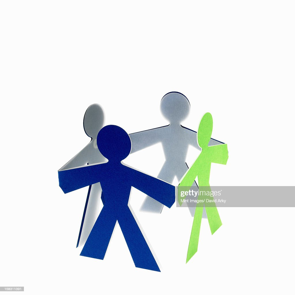 Papercuts, paper cut out figures representing people with joined hands. : Stock Illustration