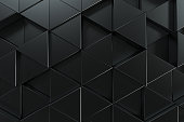 Pattern of black triangle prisms. Wall of prisms. Abstract background. 3D rendering illustration.