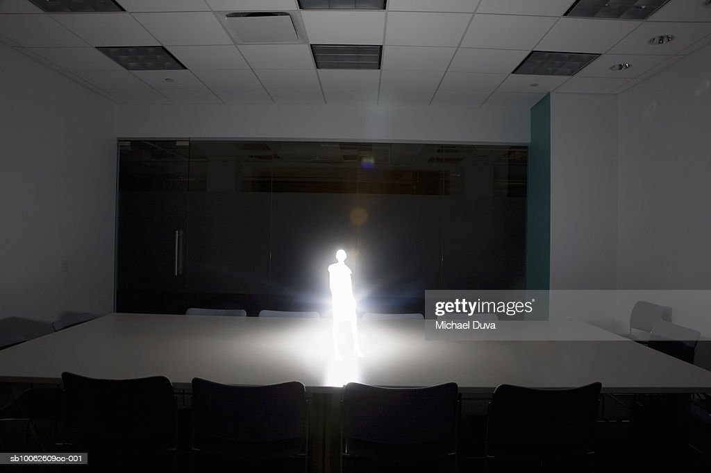 Person standing on conference table : Stock Illustration
