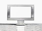 Plasma screen television on shelf (Digital)