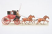 Postboy driving 1784 mail coach drawn by four horses, side view.