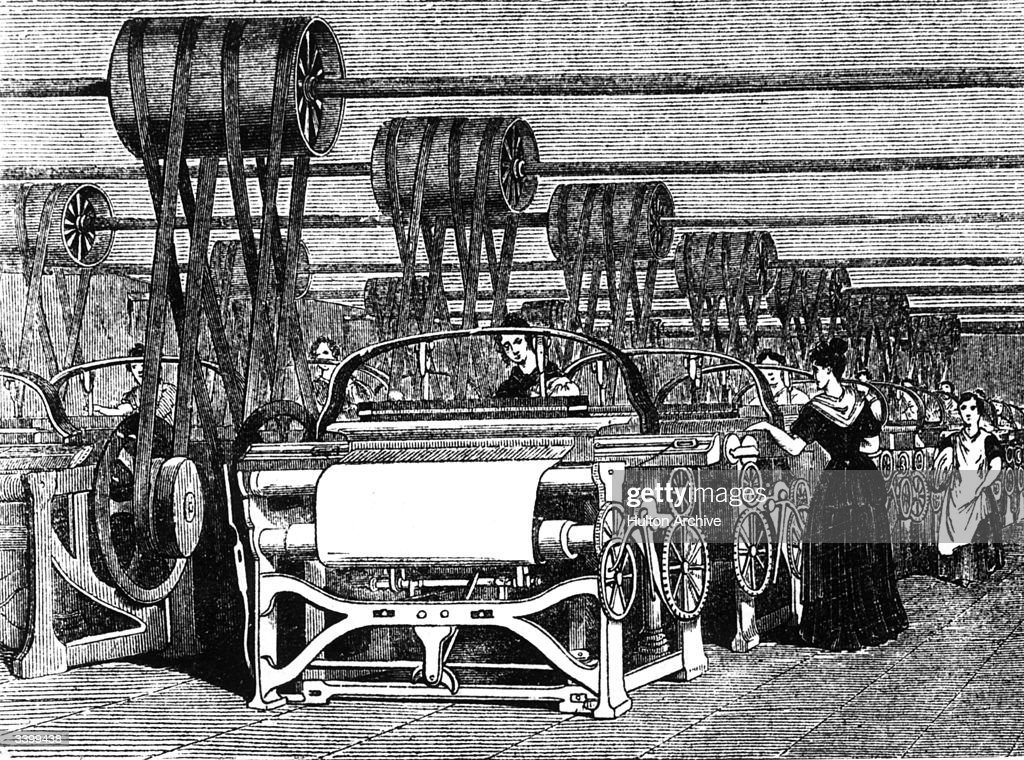 Power looms being used in textile manufacturing during the industrial revolution.