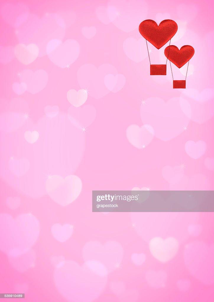 Rojo corazón globo aerostático sobre rosa corazón fondo bokeh : Ilustración de stock