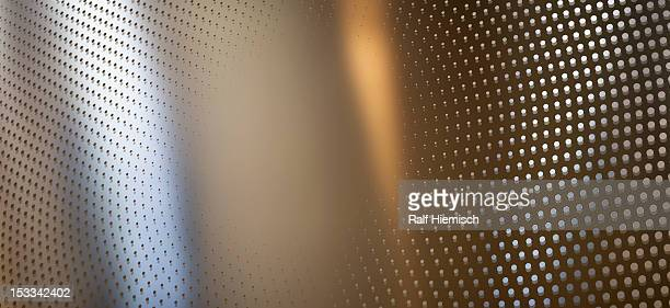 Round dot pattern against an abstract background