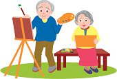 Senior man and woman painting pictures, front view